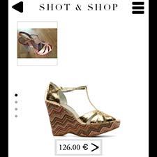 Shot & Shop sugiere una sandalia similar a la que hemos fotografiado y enseña su precio.