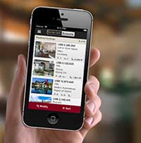 Un iPhone con la App Luxury Estate.
