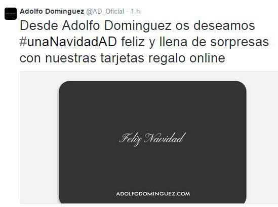 DifusiA?n en Twitter de la campaAi??a de venta de tarjetas regalo online de Adolfo DomAi??nguez.